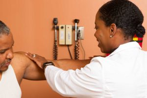 Doctor Inspecting Patient's Arm