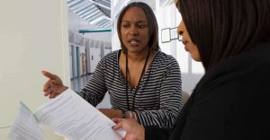 Employee Explaining Documents to Patient
