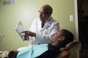 Doctor Reviewing Medical Diagram With Patient