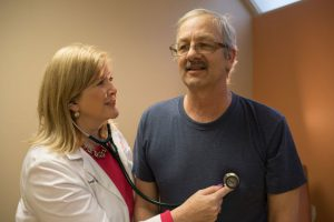 Doctor Checking Patient's Heartbeat with Stethoscope