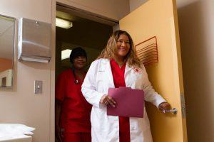 Doctor and Nurse Entering Room
