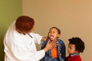 Doctor Inspecting Child's Throat
