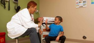 Doctor Working With Child